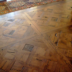 Versailles Parquet - Eccologie supplied this exaggerated distressed floor, it is a replica of a Versailles Parquet pattern made with reclaimed oak planks which are designed in a jig, reassembled and held together with pegs.This process takes great skill and time but the result is stunning.