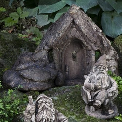 Campania International Short Gnome Home Cast Stone Garden Statue - About Campania InternationalEstablished in 1984, Campania International's reputation has been built on quality original products and service. Originally selling terra cotta planters, Campania soon began to research and develop the design and manufacture of cast stone garden planters and ornaments. Campania is also an importer and wholesaler of garden products, including polyethylene, terra cotta, glazed pottery, cast iron, and fiberglass planters as well as classic garden structures, fountains, and cast resin statuary.Campania Cast Stone: The ProcessThe creation of Campania's cast stone pieces begins and ends by hand. From the creation of an original design, making of a mold, pouring the cast stone, application of the patina to the final packing of an order, the process is both technical and artistic. As many as 30 pairs of hands are involved in the creation of each Campania piece in a labor intensive 15 step process.The process begins either with the creation of an original copyrighted design by Campania's artisans or an antique original. Antique originals will often require some restoration work, which is also done in-house by expert craftsmen. Campania's mold making department will then begin a multi-step process to create a production mold which will properly replicate the detail and texture of the original piece. Depending on its size and complexity, a mold can take as long as three months to complete. Campania creates in excess of 700 molds per year.After a mold is completed, it is moved to the production area where a team individually hand pours the liquid cast stone mixture into the mold and employs special techniques to remove air bubbles. Campania carefully monitors the PSI of every piece. PSI (pounds per square inch) measures the strength of every piece to ensure durability. The PSI of Campania pieces is currently engineered at approximately 7500 for optimum strength. Each piece is air-dried and then de-molded by hand. After an internal quality check, pieces are sent to a finishing department where seams are ground and any air holes caused by the pouring process are filled and smoothed. Pieces are then placed on a pallet for stocking in the warehouse.All Campania pieces are produced and stocked in natural cast stone. When a customer's order is placed, pieces are pulled and unless a piece is requested in natural cast stone, it is finished in a unique patinas. All patinas are applied by hand in a multi-step process; some patinas require three separate color applications. A finisher's skill in applying the patina and wiping away any excess to highlight detail requires not only technical skill, but also true artistic sensibility. Every Campania piece becomes a unique and original work of garden art as a result.After the patina is dry, the piece is then quality inspected. All pieces of a customer's order are batched and checked for completeness. A two-person packing team will then pack the order by hand into gaylord boxes on pallets. The packing material used is excelsior, a natural wood product that has no chemical additives and may be recycled as display material, repacking customer orders, mulch,or even bedding for animals. This exhaustive process ensures that Campania will remain a popular and beloved choice when it comes to garden decor.Please note this product does not ship to Pennsylvania.