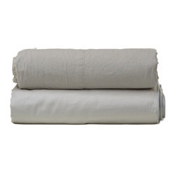 """Parachute - Parachute Percale Sheet Set In Ash - Most easily compared to the perfect white shirt, Parachute's percale sheet set is cool and crisp to the touch, with a lovely matte finish. It's everything you need to achieve that perfectly lived-in bedroom style. Each fitted sheet features a continuous elastic hem and 16"""" deep corner pockets. The signature Parachute pillowcases are designed with a center-back envelope closure that's meant to hug a pillow tight and create a clean look."""