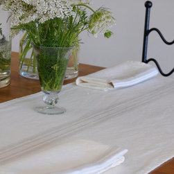 """Origin Crafts - Maison white/natural linen table runners - Maison White/Natural Linen Table Runners 100% linen. We have a wide collection of 100% linen table runners to suit your decor style, ranging from solid to jacquard,casual to luxurious and contemporary to French country chic. They can be placed along the table or across it, depending on the look that you want to achieve. Beautiful hemstitched edges highlight the sophistication of a linen runner and make it an attractive element in any interior. Dimensions (in): 17"""" x 67"""" 17"""" x 108"""" By Linen Way - Linen Way is a family-owned wholesale business that sells the finest home textiles, handpicked from around the world. Linen Way offers inspirational products for your life and home in traditional and modern designs. Estimated Delivery Time 1-2 Weeks. Please be aware that some products are handmade and unique therefore there may be slight variations in each individual product."""
