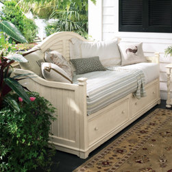 Universal Furniture - Paula Deen Day Bed in Linen - This day bed from Universal Furniture's Paula Deen Home Collection is both beautiful and multipurpose.  The beauty is apparent in the lightly distressed linen finish and slatted accents on the back and sides.  The multipurpose aspect exceeds the usual day bed functionality - that it can also serve as seating - because the base comes with two drawers for storage.  Constructed of birch veneers over hardwoods, this day bed is as well-built as it is versatile.