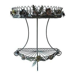 Pre-owned Demilune Enamel Flower Table - Vintage demilune plant stand or occasional table with applied flowers and leaves. Metal French-style wire.  Detail on flowers is gorgeous.  Top shelf is fitted with an amber-tinted mirror, not original to the piece but custom fitted.  Some minor paint wear in limited spots that in no way detract from the piece.