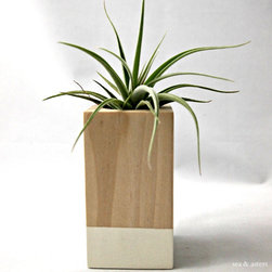 Oatmeal/Wood Color-Block Cube Container by Sea & Asters - This artful block is two toned (natural wood and white) and allows for a small plant. I love how simple and beautiful it is. It's a great gift, especially for the hostess this season.