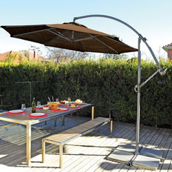 "Coolaroo - 10' Round Cantilever Patio Umbrella - Cantilever umbrellas bring a sense of style to any outdoor setting without obstructing views or requiring much space. This umbrella features Coolaroo knitted fabric made from UV stabilised high density polyethylene materials. It features a special lock knit construction that blocks up to 90% of harmful UV sun rays while generating cooling breezes underneath. The aluminum frame is lightweight and the crank lift mechanism enables easy operation and positioning of the shade canopy. Perfect for patios, decks and other outdoor settings. Features: -10' Round cantilever umbrella.-Made from UV stabilised materials to block up to 90% of harmful UV sun rays.-Easy to clean fabric with soap and water.-Provides up to 90% UV protection.-Knitted fabric is breathable.-Folds and unfolds easily.-Slide Tilt.-Pole Finish: Powder Coated.-Distressed: No.-Powder Coated Finish: Yes.-Gloss Finish: No.-Marine Varnish: No.-Canopy Material: HDPE Knitted material.-Canopy Color: Mocha.-Hardware Material: Stainless steel.-Mildew Resistant: Yes.-Rust Resistant: Yes.-Fade Resistant: Yes.-Stain Resistant: Yes.-UPF Protection: Yes.-Opening Method: Smooth action crank mechanism.-Number of Canopy Ribs: 6.-Rib Material: Steel.-Base Included: No.-Recommended Base Size: 30 lbs.-Number of Poles: 1.-Number of Pieces in Pole: 2.-Tilt: Yes.-Rotation: No.-Lock Mechanism: Crank handle with ratchet.-Wind Vent: No.-Collapsible: Yes.-Illuminated: No.-Solar Powered: No.-Wall Mounted: No.-Mesh Netting: No.-Finial: No.-Tassels: No.-Valance: No.-Pointed Pole: No.-Adjustable Height: No.-Storage Bag Included: No.-Swatch Available: No.-Commercial Use: Yes.-Eco Friendly: No.-Recycled Content: No.-Total Recycled Content (Percentage): 0%.-Post-Consumer Content (Percentage): 0%.-Remanufactured/Refurbished : No.-Product Care: Clean easily with hose and mild cleanser.Specifications: -FSC Certified: No.Dimensions: -Open Umbrella Width: 120"".-Open Umbrella Depth: 120"".-Pole Height: 102"".-Pole Diameter: 1.6"".-Base Hole Diameter: 1.6"".-Overall Product Weight: 38 lbs.Assembly: -Assembly Required: No.-Additional Parts Required: Yes.-Parts Needed: Pavers or sand bags/weights to secure umbrella cross bars at bottom.Warranty: -Product Warranty: 1 year on parts / 5 years on fabric UV degradation."