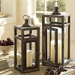 """Camden Wood Lantern, Small - Perfect indoors, or outdoors in a protected area, this handcrafted lantern's simple design is enhanced by an elegant door latch and a stepped finial on top. Small: 6.5"""" square, 18.75"""" high Large: 8"""" square, 23.25"""" high Made of pine wood. Tin sheet metal with a gray finish. Glass panes. For both indoor and outdoor use."""