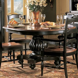 Hooker Furniture Indigo Creek Round Dining Table - With the kind of sturdy looks to anchor your dining space, the Indigo Creek Round Dining Table provides the perfect backdrop to your delicious dinners. The black rub-through finish base provides a stable feeling and the round solid wood and wood veneer top is the icing on the proverbial cake. Bring traditional design to a new level with this gorgeous and unique design.Not available for sale in, or delivery to, the state of California. About Hooker Furniture CorporationFor 83 years, Hooker Furniture Corporation has produced high-quality, innovative home furnishings that seamlessly combine function and elegance. Today, Hooker is one of the nation's premier manufacturers and importers of furniture and seeks to enrich the lives of customers with beautiful, trouble-free home furnishings. The Martinsville, Virginia, based company specializes in lifestyle driven furnishings like entertainment centers, home office furniture, accent tables, and chairs. Construction of Hooker FurnitureHooker Furniture chooses solid woods and select wood veneers over wood frames to construct their high-quality pieces. By using wood veneer, pieces can be given a decorative look that can't be achieved with the use of solid wood alone. The veneers add beautiful accents of color and design to the pieces, and are placed over engineered wood product for strength. All Hooker wood veneers are made from renewable resources and are located primarily on the flat surfaces of the furniture, such as the case tops and sides. Each Hooker furniture piece is finished using up to 30 different steps, including 13 steps of hand-sanding and accenting. Physical distressing is done by hand. Pieces receive two to three coats of solid lacquer to create extra depth and add durability to the finish. Each case frame is assembled using strong mortise-and-tenon joints, which are then reinforced by mechanical fasteners and glue. On most designs, end panels extend to the floor to add strength and stability. Panel-style furniture features strong panel and frame construction to help avoid warping. Your Hooker furniture features finished case interiors to eliminate unsightly raw wood and to help protect items you may store inside drawers or cabinets. Drawer parts are given a urethane or lacquer finish to create smooth action and durability. All drawers use dovetails, either English or French, for years of problem-free use. Drawer bottoms are constructed from plywood and attached to the plywood drawer sides via the use of hot glue and/or wood glue blocks. Most drawers are full width, depth, and height to provide the maximum amount of storage space.
