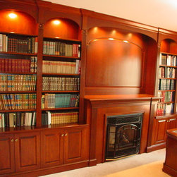 Custom Designed Cabinets - Custom built and designed fireplace bookcases and mantel in a home office