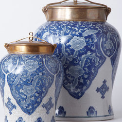 Blue and White Jar with Bronze Lid - Large - Classic cultural d�cor in striking blue and white porcelain is delicately hand painted with finely detailed lotus flowers fit for a palace. Enrapture your visitors with an exquisite temple jar inspired by those that perched in Temples of Asia in historic times. Topped with a delicate bronze lid to finish the piece - a true conversation piece in a classic form.