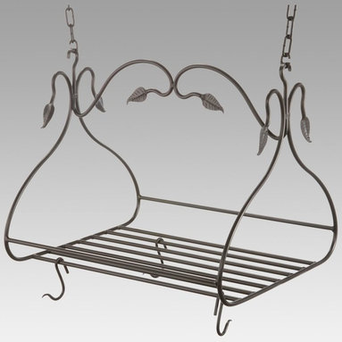 Metal Creations - Gourmet Pot Rack with 8 Canterbury Hooks - Large Multicolor - 901-463 - Shop for Pot Racks from Hayneedle.com! Short on cabinet space? It's a problem many of us experience especially in older homes and apartments. Free up some space by using our Gourmet Pot Rack with Eight Canterbury Hooks to hang your pots and pans. It's an attractive addition to any kitchen and the large center grid can double as a shelf giving you even more storage options. Crafted from hand-forged iron it has a scrolling leaf pattern and a natural black finish that will blend in beautifully with any kitchen decor. The eight Canterbury hooks are loose allowing you to place them in any configuration and you can purchase additional 1-foot sections of chain to accommodate high ceilings. Made in the USA. Dimensions: 36L x 19W x 18H inches. Weighs 26 pounds.About Stone County Ironworks.Stone County Ironworks creates heirloom hand-forged iron furniture. The company's blacksmiths use artistic ability and traditional tools like the hammer anvil and forge to create unique works of art naturally. For 30 years Stone County Ironworks has worked with designers and dreamers all over the country - sometimes forging through a completed drawing provided by a client and sometimes working only with an idea to discover and create just the right design. The company's quality workmanship that reflects the skill of the blacksmith continues to set it apart from other manufacturers.