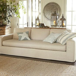"Solano Slipcovered Grand Sofa, Down-Blend Wrap Cushions, Linen Silver Taupe - Casual and comfortable, our Solano Grand Sofa makes room for the whole family. True to the fine craftsmanship of our master upholsterers in North Carolina, it's built with exceptional structural integrity and straightforward style. 105"" w x 41"" d x 36"" h {{link path='pages/popups/PB-FG-Solano-3.html' class='popup' width='720' height='800'}}View the dimension diagram for more information{{/link}}. {{link path='pages/popups/PB-FG-Solano-4.html' class='popup' width='720' height='800'}}The fit & measuring guide should be read prior to placing your order{{/link}}. Down-blend wrapped cushions provide a casual and relaxed look. Proudly made in America, {{link path='/stylehouse/videos/videos/pbq_v36_rel.html?cm_sp=Video_PIP-_-PBQUALITY-_-SUTTER_STREET' class='popup' width='950' height='300'}}view video{{/link}}. For shipping and return information, click on the shipping info tab. When making your selection, see the Special Order fabrics below. {{link path='pages/popups/PB-FG-Solano-5.html' class='popup' width='720' height='800'}} Additional fabrics not shown below can be seen here{{/link}}. Please call 1.888.779.5176 to place your order for these additional fabrics."