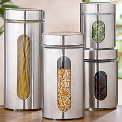 Round Glass Storage Jars, Sets of 2 - Storage Containers - I recently read about this woman who strives for zero waste and lugs containers like these to Whole Foods to avoid bringing wasteful packaging into her home. While we (and your area's Whole Foods) might not be quite there yet, why not get ready with these gorgeous food containers? They are sure to pretty up your pantry.
