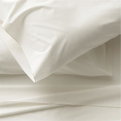 Belo Ivory California King Sheet Set - Clean, basic white bedding upgrades in soft, smooth cotton percale, beautifully contrasted with a graceful ivory overlocking stitch on the flat sheet and pillowcase. Generous fitted sheet pockets accommodate thicker mattresses. Sheet set includes one flat sheet, one fitted sheet and two pillowcases. Bed pillows also available.