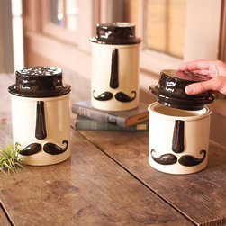 Manly Canisters - Set of 3 - Make some space on the counter for this quirky kitchen storage. Your pantry goods have never looked as good as they do in these handsome mustachioed canisters. With a trendy graphic on fine ceramic, they'll make organizing your kitchen more fun than ever.