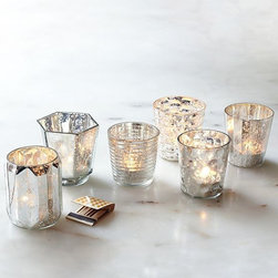 Mercury Votive Holders - For instant ambiance at dinner parties and holiday celebrations, a stash of glittering mercury glass votive holders are inexpensive and high impact.