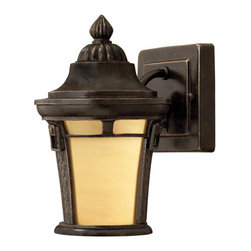 Key West Wall-Mount Lantern - Energy Saving Fluorescent - Regency Bronze - Petite in size, the Key West Wall-Mount Lantern is ideal for small entryways. Features a smooth antiqued vanilla glass shade along with a basket weave design and detailing on the body.
