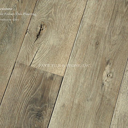Provence Ancienne Wide Plank French Oak Flooring Collection - We define Pavé by a French and European ambiance. In a all that we do, we never lose touch with the elegance of the French aesthetic. This translates to our Provence Ancienne vintage wide-plank French oak flooring collection. Using only French oak, we age and hand-finish each plank, using old world French techniques brought from Europe into our Massachusetts studios. Producing our own aged and pre-finished planks allows for the highest quality control, flexibility, competitive price point and ETA. Working with the tannins of the wood - we age the oak planks by transforming it's composition. The result is authentic and beautiful. We also offer custom stair treads, risers, trim and baseboards to make an installation complete.