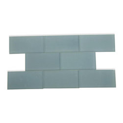 "Loft Blue Gray Frosted Glass Tile - Loft Blue Gray Frosted 3x6 Glass Tile This blue gray subway tiles are decorative and durable, making it a great back drop. The glass tile will reflect the light in your room, giving it a fresh, clean and brighter look. Using a subway tile as a back splash you will add some color and style to your kitchen decor or any decorated room in your home. It will also give it a more distinct look. Chip Size: 3""x6"" Color: Blue Gray Material: Glass Finish: Frosted Sold by the Square Foot (8 pieces per square foot) Thickness: 8mm Please note each lot will vary from the next."