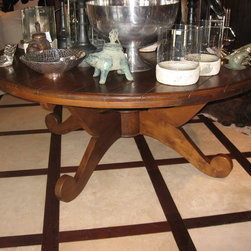 """Idlewild Furnishing - Teak dining table with plank top. The table is 78"""" in diameter."""