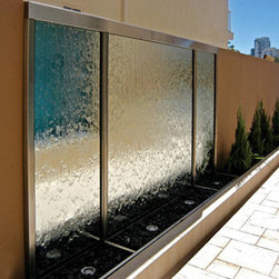 Indoor Custom Water Feature Ideas - This is an excellent example of the type of water feature that the expert builders at Water Feature Supply can create. Our fountain engineers have the experience and knowledge to help create your custom water wall project bringing even your wildest dream into reality. Every one of our custom water features is hand built with the finest quality materials in the world and fully tested to ensure longevity. This most beautiful, modern and custom water feature is made by the builders at Water Feature Supply.