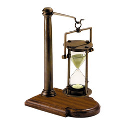 "Inviting Home - 30 Minute Hourglass on Stand - Heavyweight bronze 30 minute hourglass on wood stand; 7-3/8""W x 5-1/8""D x 10""H Heavyweight bronze 30 minute hourglass on wood stand. This hourglass designed for the Age of Sail now at home in any oval or executive office. Hourglass are highly collectable because of their combined historical and practical value. Some hourglasses measured up to two hours used at a time when church pews were designed by the Inquisition to torture the human back. Ship�s hourglasses were calibrated to the half hours of the ship�s watch and if the helmsman didn�t turn the hourglass too early it actually doubled in defining longitude. Navigators tried to keep count of the hours; the galleons wrecked on the Western Australian reefs remind us of the perils of incorrectly kept time. To appreciate the important symbolism of the hourglass observe Renaissance painted still lives also called Vanitas filled with symbolism and morals. They very often depict hourglasses"