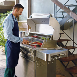 """Frontgate - Partially Assembled Saber 4-burner Gas Grill with Dual Side Burners and Cover - Constructed of rugged 304 stainless steel. 895 square inches of total cooking space. Four 8,000 BTU stainless steel burners. One 18,000 BTU dual-control side burner. Uses 30% less gas than traditional grills. This innovative grill uses a proprietary infrared cooking system that keeps meat naturally moist and tender—even when cooked to well-done. Unlike traditional gas grills that often dry out meat, Saber's exclusive cooking system generates 100% infrared heat that locks in food's natural juices and reduces cooking times. Separately controlled cooking zones let you grill a succulent filet to perfection, while simultaneously cooking mouthwatering shrimp at a lower temperature.  .  .  .  .  . 304 stainless steel cooking grates . Push-button electric ignition for reliable start-up . Adjustable warming rack . Heavy-duty 304 stainless steel side shelves . Two interior halogen lights for nighttime cooking . 3"""" dia. locking casters . Front-access grease tray for easy cleaning . Includes grate cleaning tool . Accommodates a 20 lb. liquid propane tank (not included); Natural gas conversion kit sold separately ."""
