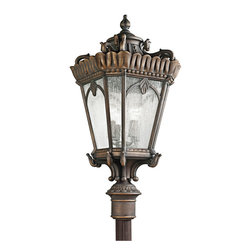 Kichler 4-Light Outdoor Fixture - Londonderry Exterior - Four Light Outdoor Fixture. The timeless lantern shape of this lighting outdoor post lantern light is accentuated by intricate details including a beaded trim and botanical accents. From the Tournai collection, clear seedy glass panels compliment the look for a surprisingly modern finishing touch. Energy efficient compact fluorescent lamp may be used: not included.