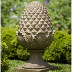 Campania International Williamsburg Grand Pinecone Cast Stone Garden Statue - About Campania InternationalEstablished in 1984, Campania International's reputation has been built on quality original products and service. Originally selling terra cotta planters, Campania soon began to research and develop the design and manufacture of cast stone garden planters and ornaments. Campania is also an importer and wholesaler of garden products, including polyethylene, terra cotta, glazed pottery, cast iron, and fiberglass planters as well as classic garden structures, fountains, and cast resin statuary.Campania Cast Stone: The ProcessThe creation of Campania's cast stone pieces begins and ends by hand. From the creation of an original design, making of a mold, pouring the cast stone, application of the patina to the final packing of an order, the process is both technical and artistic. As many as 30 pairs of hands are involved in the creation of each Campania piece in a labor intensive 15 step process.The process begins either with the creation of an original copyrighted design by Campania's artisans or an antique original. Antique originals will often require some restoration work, which is also done in-house by expert craftsmen. Campania's mold making department will then begin a multi-step process to create a production mold which will properly replicate the detail and texture of the original piece. Depending on its size and complexity, a mold can take as long as three months to complete. Campania creates in excess of 700 molds per year.After a mold is completed, it is moved to the production area where a team individually hand pours the liquid cast stone mixture into the mold and employs special techniques to remove air bubbles. Campania carefully monitors the PSI of every piece. PSI (pounds per square inch) measures the strength of every piece to ensure durability. The PSI of Campania pieces is currently engineered at approximately 7500 for optimum strength. Each piece is air-dried and then de-molded by hand. After an internal quality check, pieces are sent to a finishing department where seams are ground and any air holes caused by the pouring process are filled and smoothed. Pieces are then placed on a pallet for stocking in the warehouse.All Campania pieces are produced and stocked in natural cast stone. When a customer's order is placed, pieces are pulled and unless a piece is requested in natural cast stone, it is finished in a unique patinas. All patinas are applied by hand in a multi-step process; some patinas require three separate color applications. A finisher's skill in applying the patina and wiping away any excess to highlight detail requires not only technical skill, but also true artistic sensibility. Every Campania piece becomes a unique and original work of garden art as a result.After the patina is dry, the piece is then quality inspected. All pieces of a customer's order are batched and checked for completeness. A two-person packing team will then pack the order by hand into gaylord boxes on pallets. The packing material used is excelsior, a natural wood product that has no chemical additives and may be recycled as display material, repacking customer orders, mulch,or even bedding for animals. This exhaustive process ensures that Campania will remain a popular and beloved choice when it comes to garden decor.Please note this product does not ship to Pennsylvania.