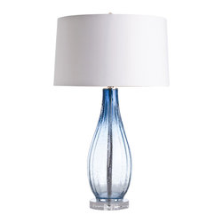 Arteriors - Parkland Lamp - You'll be swimming in style with this beautiful lamp on your end table, console or desk. The tall base is made of waves of glass that undulate from marine blue to clear, accented with tiny bubbles. It will add a perfect touch of serene color and classic form to your room.
