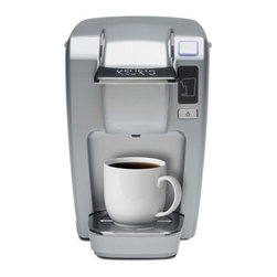 Keurig K10 Mini Plus Personal Coffee Maker - Platinum - After a while, you'll realize that every time you make a full pot of coffee, you only enjoy the very first cup, so make every cup into the first cup with the Keurig K10 Mini Plus Personal Coffee Maker – Platinum. The rugged design is perfectly sized to fit on any home or office countertop. Using a single K-cup, you can have coffee, tea, cocoa, or a myriad of other beverages in just under a minute. Choose from three different brewing sizes for your cup, mug, or extra-large java fix. There's even an automatic shut-off that keeps you from using electricity you don't need. The design is made to last and it's just as easy to clean. Includes 6 K-cups.About KeurigCustomers have come to expect nothing less than excellence when it comes to Keurig. In 1998, Keurig introduced their patented single-cup brewing system that simplifies and enhances the process for brewing one cup of coffee, which takes less than a minute and is as easy as could be. Now, Keurig is the leading single-cup brewing system in North America. With the expectation that coffee should always be served fresh, Keurig's mission is to provide state-of-the-art brewer technology and unique packs to consistently deliver the perfect cup of coffee.