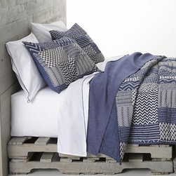 Aman Full-Queen Quilt - Ethnic-inspired patches of blue-and-white chevrons, herringbones, and casual stripes print on soft 100% cotton with the heirloom look of patchwork. Filled with warming fill, cotton shell is quilted for a lightweight, insulating layer that works great on its own in warmer months. All linens reverse to solid blue. Sham has generous overlapping back closure. Bed pillows also available.