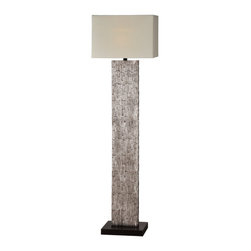 Santa Fe Floor Lamp - The body of the Santa Fe lamp is rich and refined with its aged silver leafing and exquisite bark like texture. Finished with a trimless off white linen shade and black base. Shipped in 2 boxes.