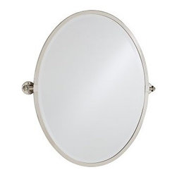 "Kensington Pivot Mirror, Oval, Satin Nickel finish - With a simple design and functional details, our best-selling Kensington Mirror is an elegant update to a bath. Regular: 27.5"" wide x 27"" high x 3"" deep Large: 28"" wide x 32"" high x 3"" deep Frame is made of aluminum with MDF backing. Pivots vertically. Beveled mirror. Zinc-alloy bracket. Moisture resistant."