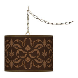 "Giclee Glow - Traditional Mocha Flourish Giclee Glow 13 1/2"" Brass Swag Pendant - Add fresh style and a stylish lighting accent with this swag chandelier. This design features an exclusive giclee pattern custom-printed onto a translucent styrene shade. This allows warm light to shine through the shade illuminating the pattern and creating a spectacular look. Installation is easy simply drape the cord on the included swag hooks then plug in to any standard wall outlet and turn on! Custom made to order. Antique brass finish. Custom printed translucent styene shade. Exclusive giclee printed pattern. Includes swag hooks and mounting hardware. Maximum 100 watt bulb (not included). In-line on/off switch. Shade is 13 1/2"" wide 10"" high. Includes 15 feet lead wire 10 feet chain.  U.S. Patent # 7347593.  Antique brass finish.  Custom printed translucent drum shade.  Exclusive Mocha Flourish giclee printed pattern.  Includes swag hooks and mounting hardware.  Maximum 100 watt bulb (not included).  In-line on/off switch.  Shade is 13 1/2"" wide 10"" high.  Includes 15 feet lead wire 10 feet chain."