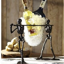 """Walking Dead Glass Serve Bowl & Stand - Startling skeletons carry a serve bowl that can hold food or refreshments. 20.25"""" wide x 9"""" deep x 14.75"""" high Made of cast aluminum with a bronze finish."""