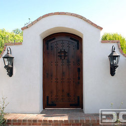 Dynamic Garage Door - A Laguna Beach, CA Spanish Colonial Gate Handcrafted in Rustic Alder Wood - Designed to suit this charming Spanish Bungalow in Laguna Beach, this Spanish entry courtyard gate is the focal point and entry way to the beautifully renovated Spanish Bungalow complete with terra cotta roof tiles, plastered courtyard walls and architectural features that have been discerningly put together. We put the frosting on the cake with our architecturally correct courtyard gate.  We can do the same for your home.  Let Dynamic Garage Door who you what true customization is and the potential your home's architecture really has!