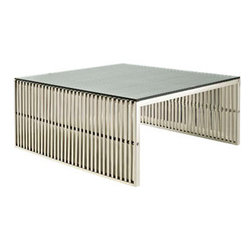 "LexMod - Gridiron Coffee Table in Silver - Gridiron Coffee Table in Silver - Straight lines were once deemed the realm of strict logic. This conduit design accomplishes something quite profound. It blends linear components with a pleasantly stainless steel tubular effect. Modernism used to be about extremes. Wild shapes and patterns that dont dare resemble its predecessors. Weve reached an age of maturity of sorts. We appreciate style, but all the more, we respect those designs that represent a blending of cultures. The Gridiron tubular stainless steel bench is famous not for its radical shape, but for the strategic transcendence that it provides. Gridiron is perfect for reception rooms, living and lounge areas, and any other place in need of transformation. Set Includes: One - Gridiron Stainless Steel Coffee Table with Tempered Glass Top Perfect Modern Side Table, Tempered Glass Top, Stainless Steel Construction, Easy to Clean, For Indoor or Outdoor Use Overall Product Dimensions: 39""L x 39""W x 17""H - Mid Century Modern Furniture."