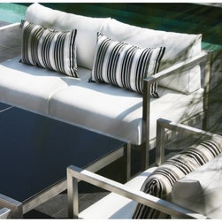 Rio Outdoor Sofa - The Rio outdoor sofa has a stainless steel frame with deep seating cushions and matching arm chairs.