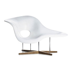 IFN Modern - Eames La Chaise Chair - Inspired by the sculpture Floating Figure a design by Gatson Lachaise, Charles and Ray Eames design their famous and elegant La Chaise Chair. Charles and Ray Eames designed this chair in 1948 for a competition at the Museum of Modern Art in New York.  This chair offers different sitting and reclining position due to its diverse designs. Overall dimensions