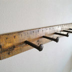 'Railway' Handmade Reclaimed Wood Spike Coat Rack by Appendage & Bough - Reclaimed wood is also magnificent on a smaller scale. I would love to hang this reclaimed wood and railway spike coat rack in my mudroom.