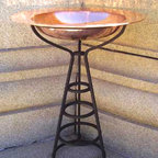Large Copper and Black Iron Birdbath - This birdbath is beautiful. The copper bowl almost looks like it's balanced on top of a growing trellis. I'm always a fan of the copper and the beautiful patina that comes over time. This would look terrific in my back yard.