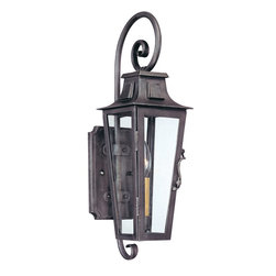 Troy Lighting - Troy Lighting French Quarter Transitional Outdoor Wall Sconce X-1692B - The hand-forged iron of the Troy Lighting French Quarter Transitional Outdoor Wall Sconce gives it the old world charm expected of the French Quarter. An aged pewter finish furthers the antique feeling of this outdoor wall light fixture. The outdoor lantern features sparkling clear glass, elegant scrolls and an elongated profile.