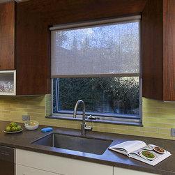 Kitchen Window coverings - Subtle and elegant, this roller shade enhances the architectural design rather than distracting from it.