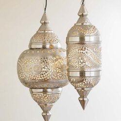 VivaTerra Moroccan Hanging Lamp - Exotic Moroccan Style has been a favorite on Houzz this year, in spite of how horrible Sex and the City II was. These intricate hand-tooled metal lanterns cast beautiful patterns on the wall and a warm soft glow. They are not your typical pendant light!