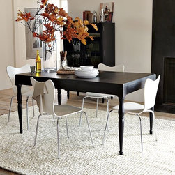"New Spencer Dining Table - An expandable table with legs to show off. A simplified take on traditional turned-leg detailing, this elegant dining table combines Victorian-era lines with a modern matte-black wood finish and more-the-merrier hospitality. It expands from 60"" to 80""with a single drop-in leaf, going from a four-top to a table for six in a snap."