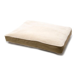 Dog Gone Smart Faux Sheepskin Dog Bed - This faux sheepskin bed from Brookstone promises to stay clean naturally and reduce the spread of bacteria.
