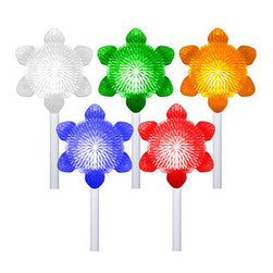 5 Snowflake Path Markers - Color Changing LED Lights - Decorate your home or yard with LED snowflake pathmarkers that change colors as they fade, chase, or twinkle. For the ultimate 'Symphony of Lights,' these pathway markers feature a built-in controller that automatically cycles randomly through the light show functions. This unique decoration offers a safe, lit-up walking path for holiday guests and is sure to surprise passing neighbors. Requires (3) 'C' cell batteries (not included).