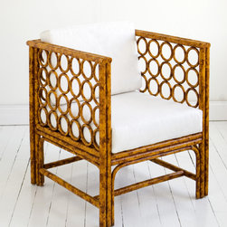 Moderne Maru Square Chair - I'm wild for these circles meeting squares in this exotic chair, and the tortoise cane material is simply to die for. Contrasted with a crisp white pillow, it's a tropical stunner.