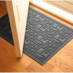 Bungalow Flooring Water Guard Nautical Indoor / Outdoor Mat - 2 x 3 ft. - Add style and protection to your home with the Bungalow Flooring Water Guard Nautical Indoor / Outdoor Mat - 2 x 3 ft.. For superior durability, this machine-made mat is constructed of high-quality polypropylene. Strong enough to handle indoor or outdoor use, this mat will be part of your home for years.About Bungalow FlooringAs a servicer of the gift and wholesale industry, Bungalow Flooring made their mark selling to more than 50 mail order, regional, and internet retailers. Serving as the retail consumer arm of The Andersen Company, a division of Georgia-based Mountville Mills, Inc., Bungalow Flooring is proud to be a domestic manufacturer of a broad range of floor covering products. Unparalleled in creative design, innovative products, service and fulfillment, only Bungalow Flooring offers such a wide array of floor coverings including personalized doormats, machine washable MicroFibres for the bath and kitchen, as well as molded polypropylene rugs.