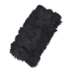 Kathy Kuo Home - Selenge Black Mongolian Sheepskin Rug - Mongolian sheepskin is irresistible and inviting with long, straight black fur. Comfortable and cozy next to your favorite armchair, covering an ottoman or hanging over a sofa, this soft sheepskin will make everyone feel at home.
