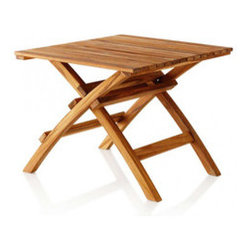 Spanish Teak Side Table - Sophisticated yet simple, and easy to fold flat for storage, this graceful table is made from fine-grained, durable, sustainably grown Laotian teak. A timeless, high-quality piece, this table will make a statement in your backyard for years to come.